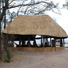 The main area is a large thatched building also overlooking the river...