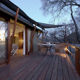 Glass sliding doors open out onto a private deck...