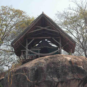 The tented rooms at Mumbo are set high on the rocks...