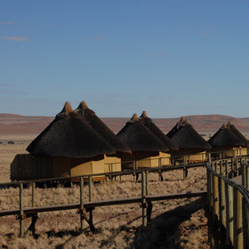Sossus Dune Lodge's 25 chalets are connected by wooden walkways...