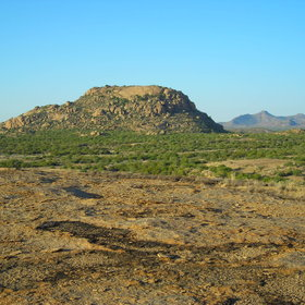 The landscape of Namibia's Central Highlands is a mix of commercial farms and rolling mountains.