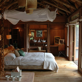 The ten spacious suites are set on raised decks in the forest.