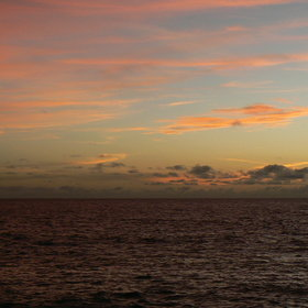 ...or enjoy the changing colours on a sunset cruise around the island.
