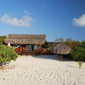 This lovely beach chalet is one of 12 at Medjumbe Private Island.