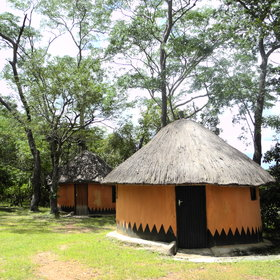 …and you can stay in one of eight thatched rondavels at Wasa Lodge…