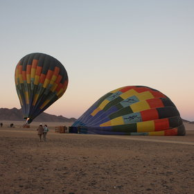 ...arrive just before sunrise to watch the balloons inflating...