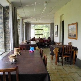 The main building contains a small dining room...