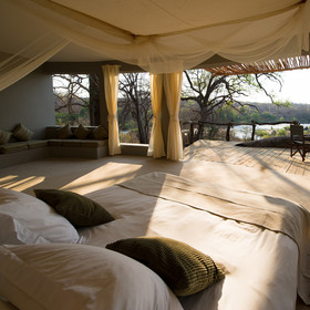 Each of Mkulumadzi's chalets is vast and light, and has...