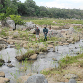 …along the shallow, boulder-dotted bed of the Mkulumadzi River.