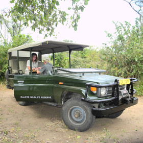 ...in the reserve's 4WDs equipped with shade canopies.