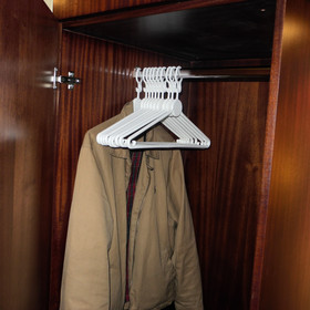 The wardrobe is small but comes with coat hangers.