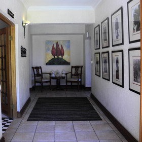 The main house has an entrance hall that leads to the reception....