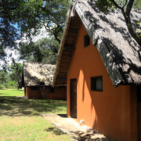 Luwombwa Camp has three ochre coloured chalets...