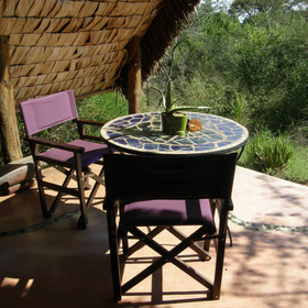 The private veranda is a lovely spot from which to enjoy the sounds of the bush.