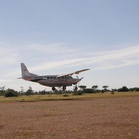 ...landing at an airstrip a short drive from the camp.