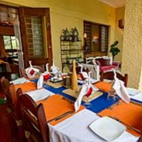 In the dining area guest can enjoy the home-cooked cuisine.