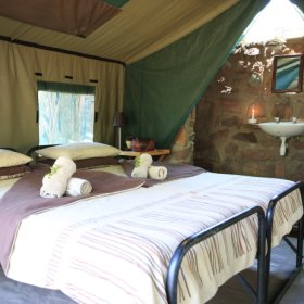 Each of the nine en-suite tents has twin beds.