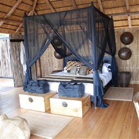 Each chalet has four-poster beds draped in mosquito netting...