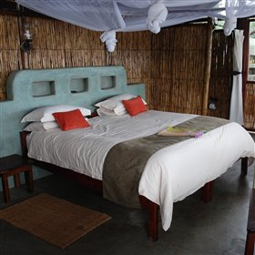 Inside each chalet is a comfortable double or twin bed...