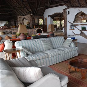 .. but inside it is very comfortable - with bright sofas beside the stone walls