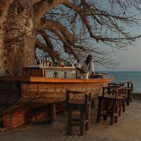 Outside, the unusual beach bar is made from an old dhow.