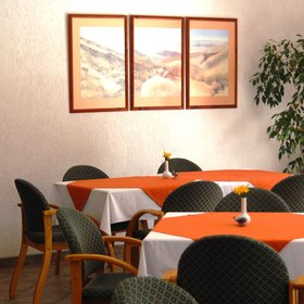 In the charming dining area there is…