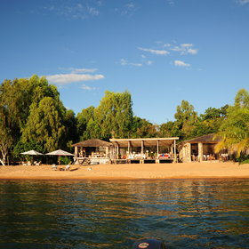 <b>Kaya Mawa</b> sits beside the implausibly clear waters of Lake Malawi.