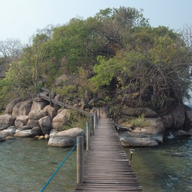 and are led via a wooden walkway to another little island where the rooms are located.