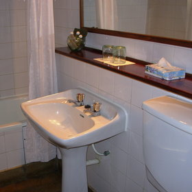 ...and provides a bright, neat en-suite bathroom.