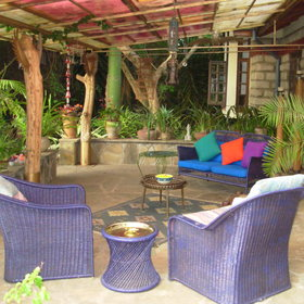 Outside there is a large veranda with brightly coloured furniture ...