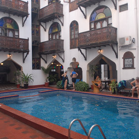 The pool is located in a courtyard in the middle of the hotel.