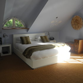 The loft suite is spacious with a bedroom...