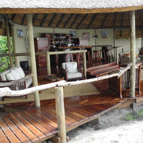 Wooden walkways link the central area to the bar where...