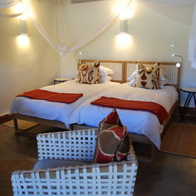 Each room has a double or twin-bed with mosquito netting...