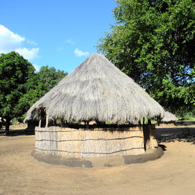 "Meals are taken in the ""nsaka"", a reed and thatched enclosure in the middle of the village."