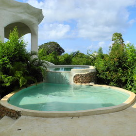 ...and a private plunge pool, overlooking the sparkling blue ocean.