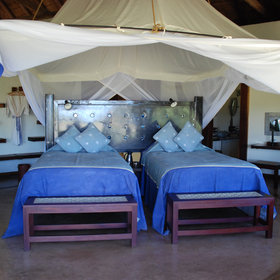 Twin beds are also available and every room benefits from mosquito nets.