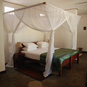 The rooms are elegant yet simple with 4-poster, king-size, hand carved beds...