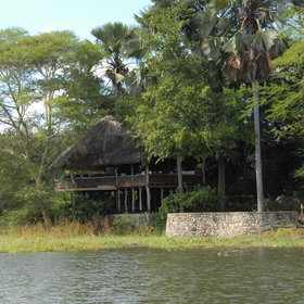 The Lodge is tucked within lush vegetation overlooking a lagoon off the Shire River.
