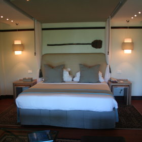 The beach villas are furnished with a snug double bed ...