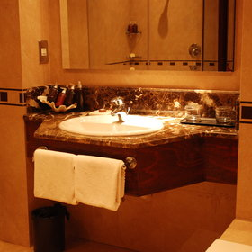 The marble-clad, en-suite bathrooms are spacious...