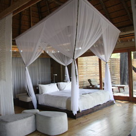 ...and a king-size bed draped in mosquito-netting.