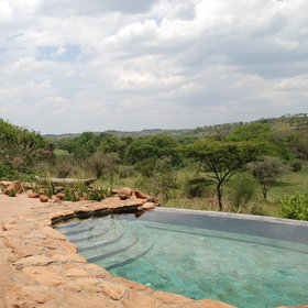 The exclusive Faru Faru Camp, in the Grumeti Reserve, overlooks the Serengeti plains.
