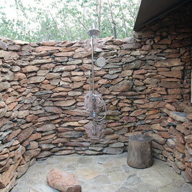 The outdoor shower is enormous - and quite magical at night...
