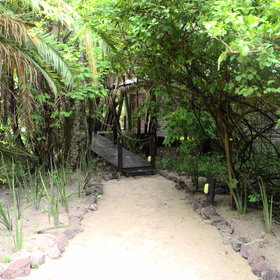 A pathway leads from the main lodge area to your room.
