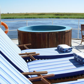 Jump into the plunge pool and relax in the deck chairs...