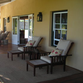 The Karoo Lodge is a beautifully restored farmhouse with wrap-around veranda..