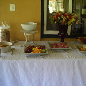 A delicious buffet of fresh fruit and cereals to choose from is set up fro breakfast.