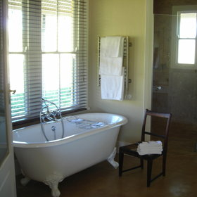 ...and a very spacious en-suite bathroom with traditional style bath and a separate shower.