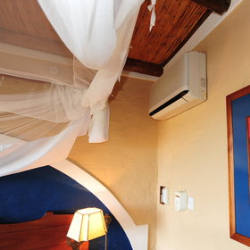 ...that are equipped with mosquito net above the beds, air conditioning...